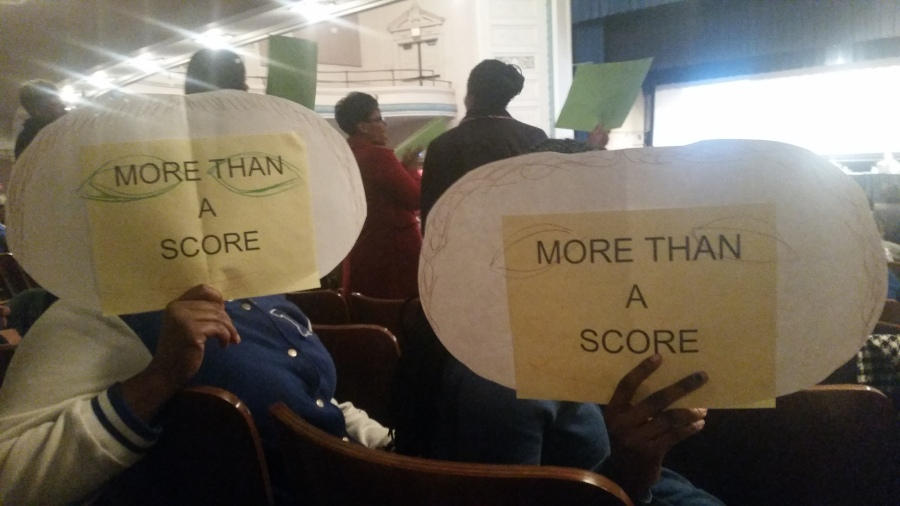 More Than A Score signs held by JFK high school students at Cleveland's Board Meeting 3-26-15